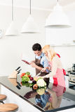 Couple cooking in stylish and modern kitchen Stock Photography
