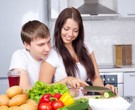 Couple cooking together Stock Photography
