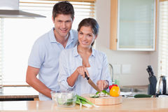 Couple cooking together Stock Photos