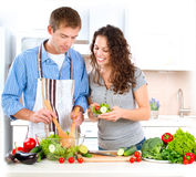 Couple Cooking Together. Happy Couple Cooking Together. Dieting. Healthy Food Royalty Free Stock Photography