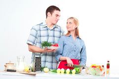 Couple of cooking together Royalty Free Stock Photos