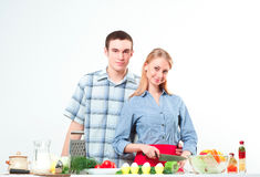 Couple of cooking together Stock Images