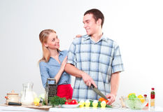 Couple of cooking together Stock Photos