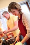 A Couple Cooking Together Stock Photography