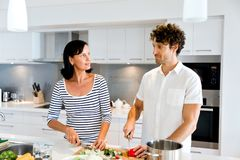 Couple Cooking Together At Home Royalty Free Stock Photo