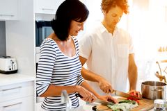 Couple Cooking Together At Home Stock Photos