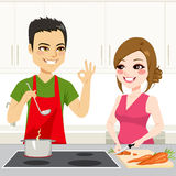 Couple Cooking Together. Cute young couple cooking a stew together on kitchen Royalty Free Stock Images