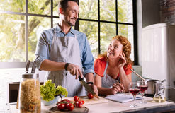 Couple cooking together a dinner Stock Photos
