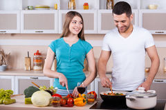 Couple cooking together. Royalty Free Stock Photography