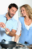 Couple cooking together at home Royalty Free Stock Images
