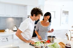 Couple cooking together at home. Couple cooking together in the modern kitchen at home Stock Image