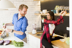 Couple cooking Stock Images