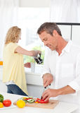 Couple cooking together in their kitchen Royalty Free Stock Photos