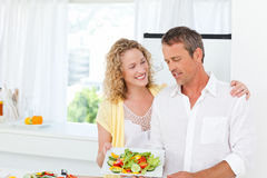 Couple cooking together in their kitchen Royalty Free Stock Photography