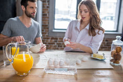 Couple cooking together Stock Image