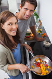 Couple cooking vegetables in the kitchen Royalty Free Stock Photos