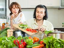 Couple cooking veggy lunch Stock Image