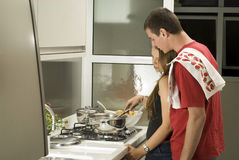 Couple Cooks in Kitchen - Horizontal royalty free stock photography
