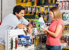 Couple With Cordless Drill In Store Stock Photos
