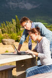 Couple correct plan of a vacation trip route and booking hotels Royalty Free Stock Photo