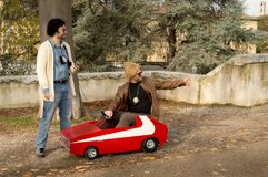 Starsky and Hutch at Lucca Comics and Games 2017. A couple of cosplayers with Starsky and Hutch costumes and even a small gran torino in the well known red Royalty Free Stock Photo