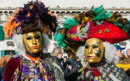 Couple in costumes and masks at the Carnival of Venice. Stock Image