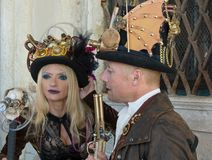 Couple in costumes and masks during the Venice carnival Stock Images