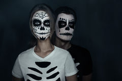 Couple in costumes of skeletons Royalty Free Stock Photos