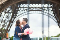 Couple with cotton candy in Paris Stock Photography