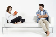 Couple on the couch. Couple separating on the couch Royalty Free Stock Photos