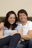 Couple on couch Royalty Free Stock Photography