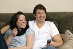 Couple on couch stock photo