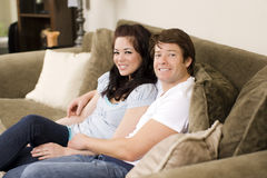 Couple on couch Royalty Free Stock Images