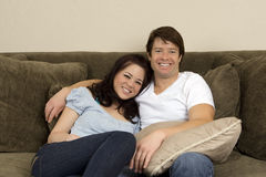 Couple on couch Royalty Free Stock Image