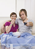 Couple  on couch Royalty Free Stock Photo