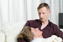 Couple on couch having free time Stock Image