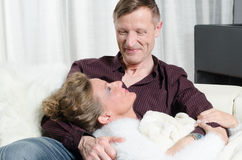 Couple on couch having free time Stock Images