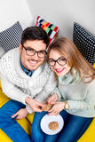 Couple on the couch at home Royalty Free Stock Images