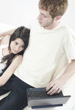 Couple on couch in living room Royalty Free Stock Images