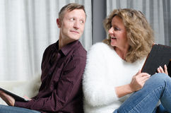 Couple on couch looking at each other Stock Image