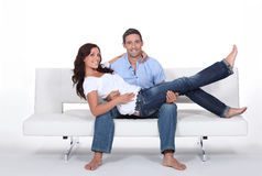 Couple on a couch Royalty Free Stock Photo