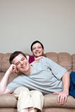 Couple on the Couch - Vertical Stock Photo