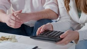 Couple counting salary money, planning budget, low incomes of average family. Stock photo stock photo