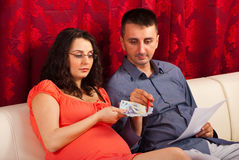 Couple counting their money Stock Images