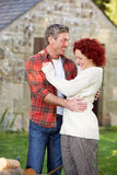 Couple in country garden Royalty Free Stock Photography