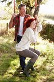 Couple in country on garden swing Stock Images