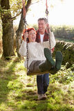Couple with country garden swing Royalty Free Stock Photo