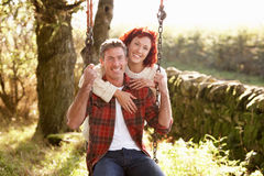 Couple with country garden swing Stock Photos