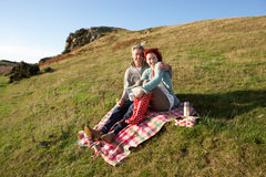 Couple on country picnic. Smiling Royalty Free Stock Photography