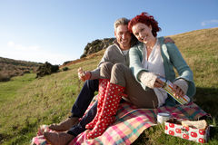 Couple on country picnic. Smiling Royalty Free Stock Photo